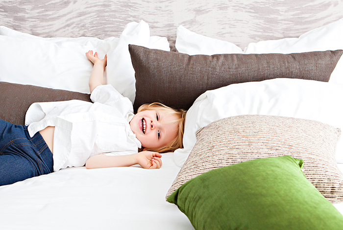 Kid on a bed