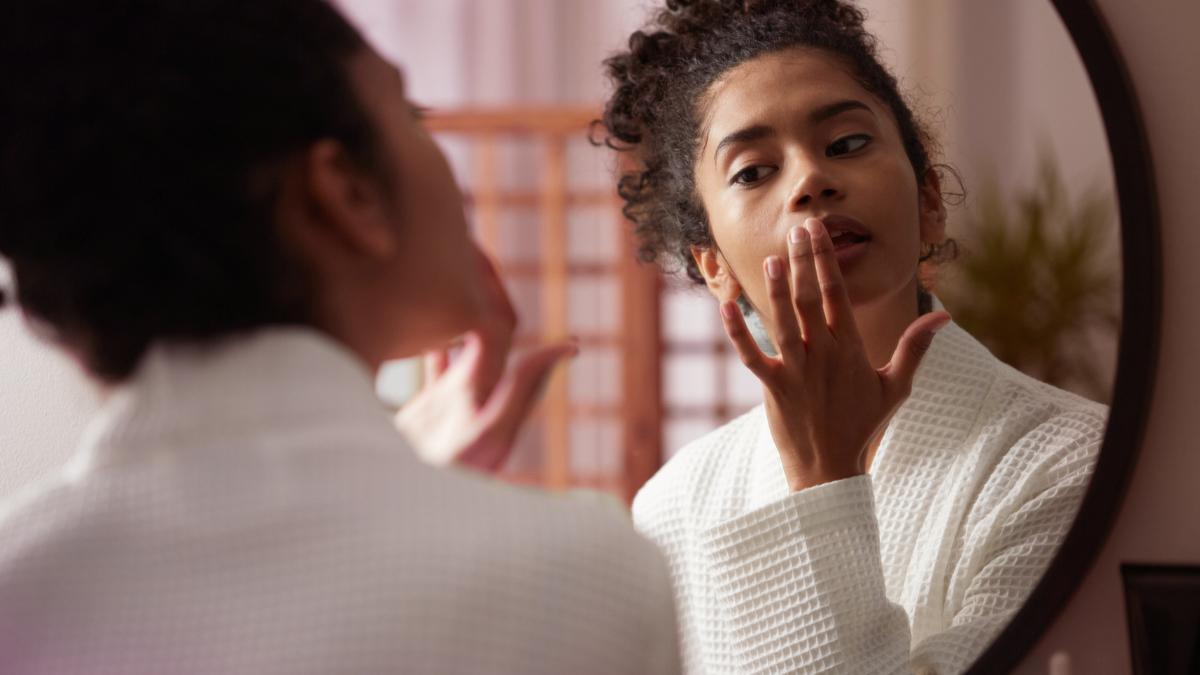 Girl putting on skincare