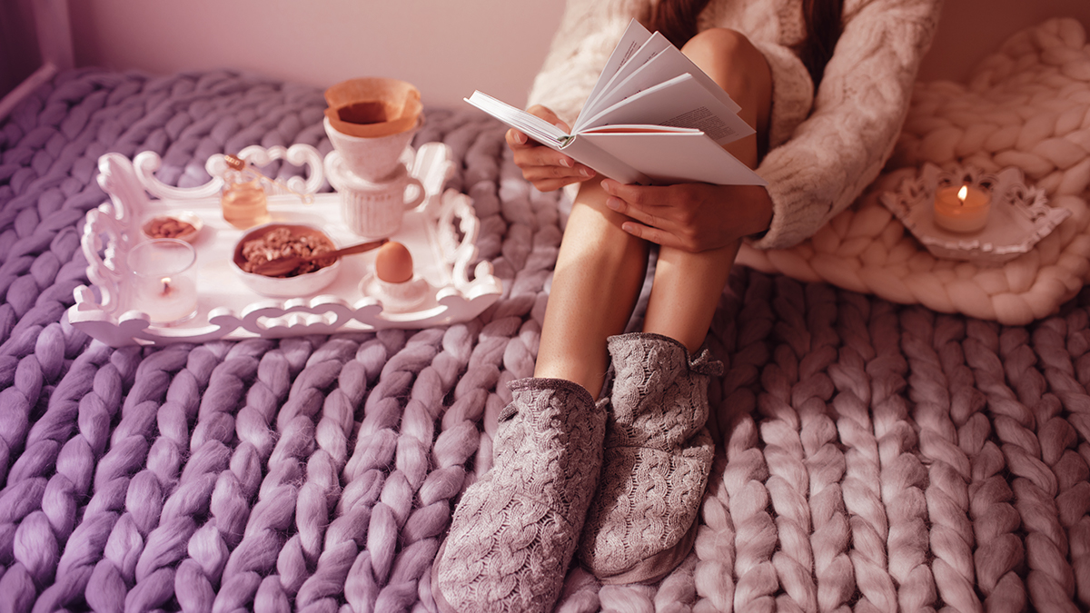 Woman wearing slippers and reading