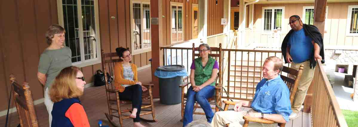 RMCers relax in rocking chairs at the 2014 Intergenerational Retreat