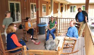 Relaxing in the rocking chairs at the 2014 Intergenerational Retreat