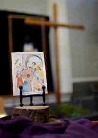 Artwork by Luz Frye of Jesus entering Jerusalem on a donkey.
