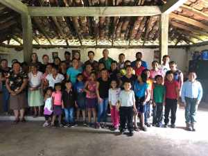 Group photo: RMC delegation with those attending morning celebration at San Romero Chapel in El Rodeo, El Salvador