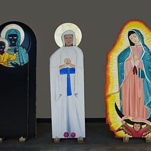 Three life-size depictions of Mary.