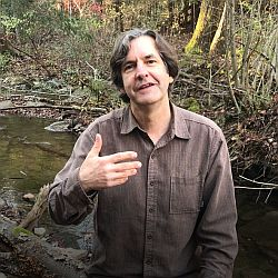 Steve Derthick portraying John the Baptist in front of a babbling creek.