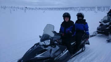 On snowmobile.