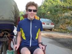Cal on a trishaw.