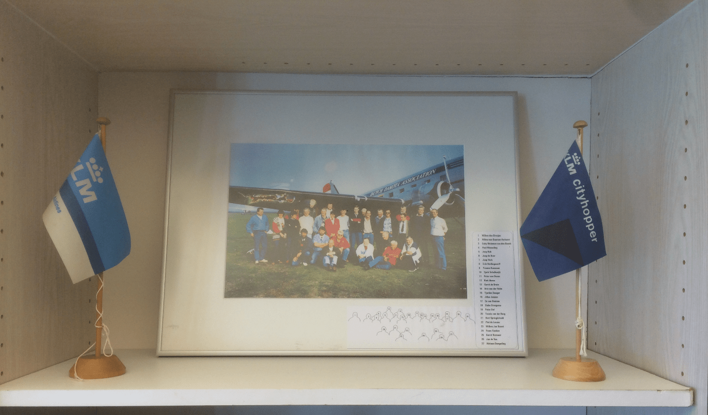 Framed picture of the crew and passengers of the Dakota DC-3 airplane on the day of the crash by IJsbrand Wildeman (The 1996 Dakota-crash in the Wadden Sea)