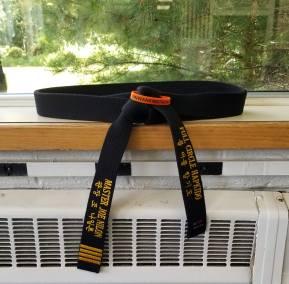 Image of a black belt sitting on a window sill