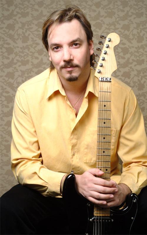 Randy Ellefson with guitar, 2004