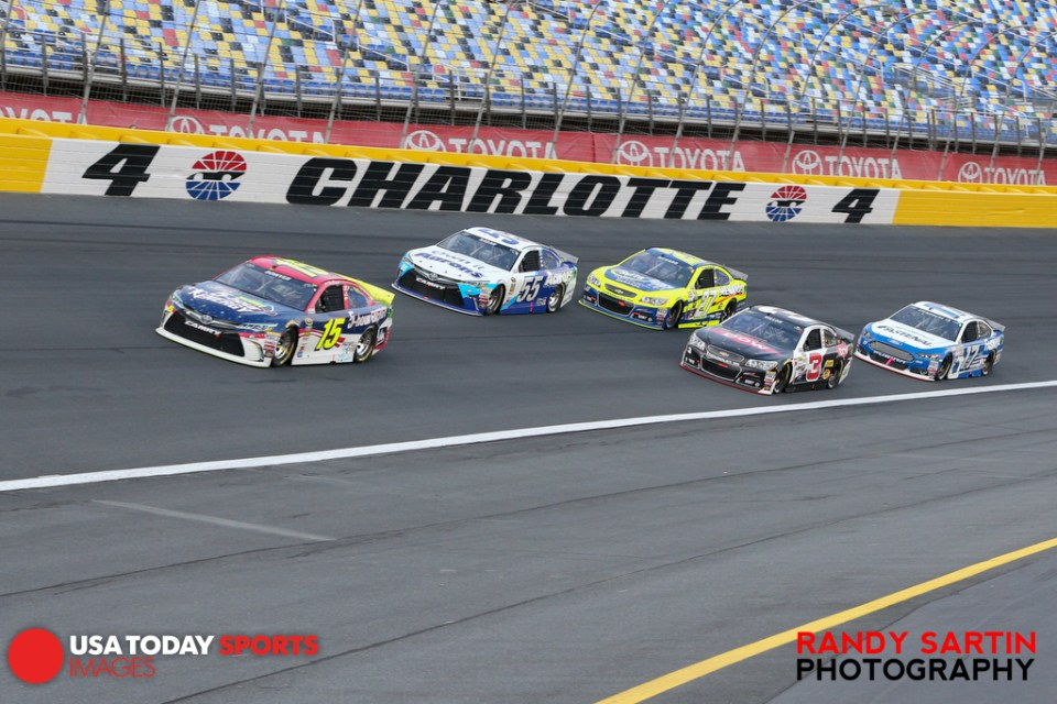 May 15, 2015; Concord, NC, USA; NASCAR Sprint Cup Series driver Clint Bowyer (15) leads during the Sprint Showdown at Charlotte Motor Speedway. Mandatory Credit: Randy Sartin-USA TODAY Sports