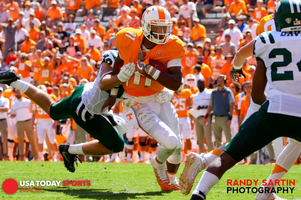 Sep 17, 2016; Knoxville, TN, USA; Tennessee Volunteers quarterback Joshua Dobbs (11) runs the ball against the Ohio Bobcats during the second half at Neyland Stadium. Tennessee won 28 to 19. Mandatory Credit: Randy Sartin-USA TODAY Sports