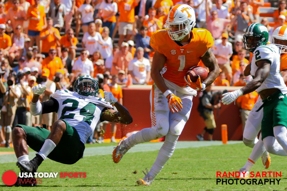 Sep 17, 2016; Knoxville, TN, USA; Tennessee Volunteers wide receiver Tyler Byrd (10) breaks a tackle from Ohio Bobcats safety Toran Davis (24) during the second half at Neyland Stadium. Tennessee won 28 to 19. Mandatory Credit: Randy Sartin-USA TODAY Sports