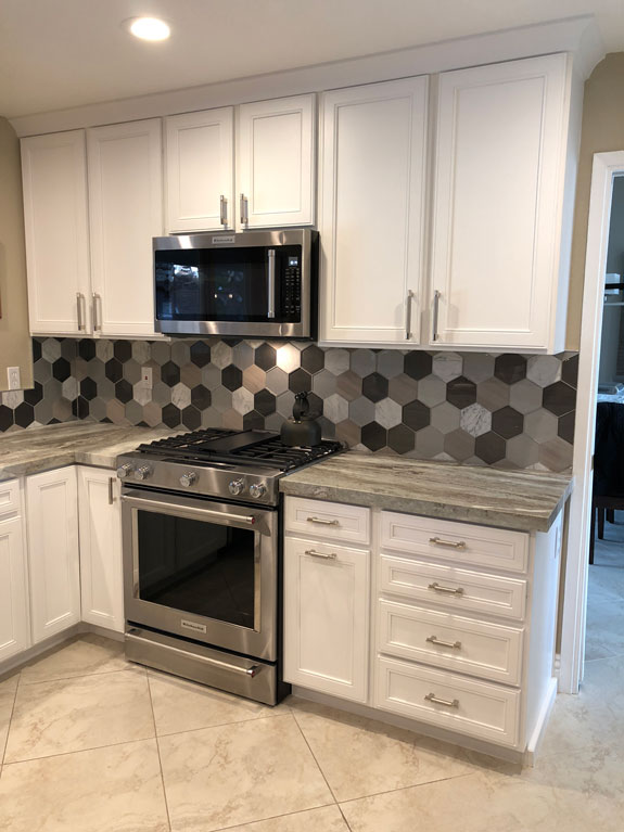 white cabinets, hexagon tile backsplash, george kovacs lighting, kitchenaid appliances, home bar, wet bar, eclectic kitchen, stainless steel, leathered granite, gooseneck faucet