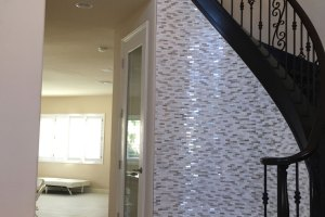 mosaic wall tile, glass mosaic tile, curved staircase, spiral staircase, glam wall tile, tiled entry wall