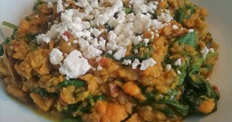 Indian curry with red lentils, sweet potato, and fresh spinach