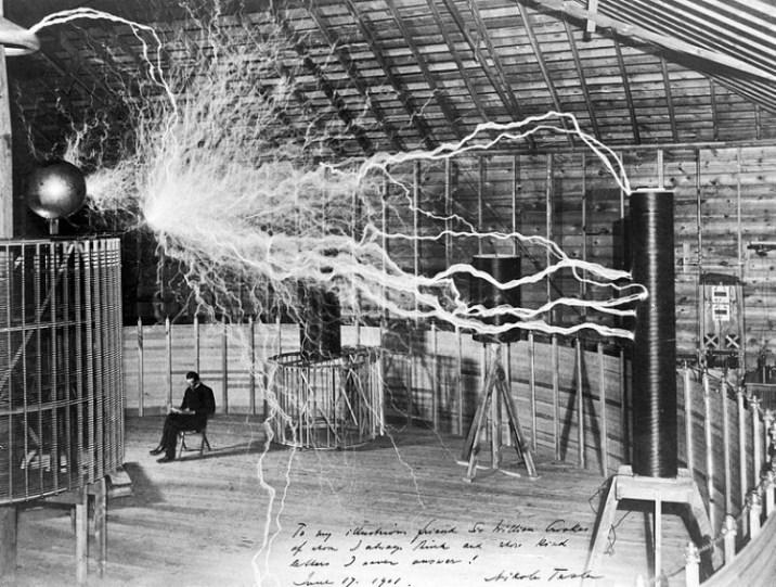 Tesla sitting in his Colorado Springs laboratory