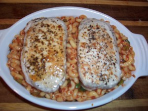 portion macaroni and place chops on top and bake