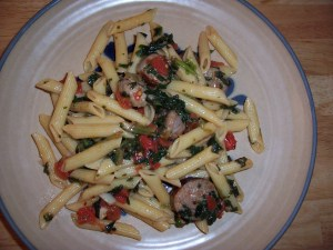 Pasta with sausage, spinach and tomato