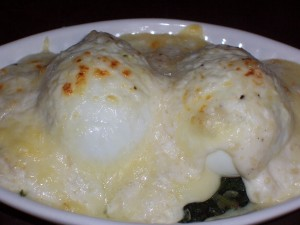 the eggs are heated and cheese and sauce beginning to brown