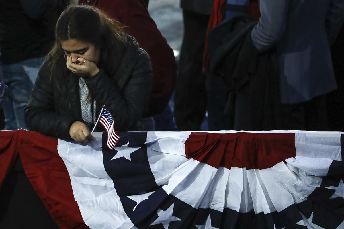 A supporter reacts after hearing that Democratic presidential nominee Hillary Clinton wouldn't be coming to the Jacob Javits Center in New York, Wednesday, Nov. 9, 2016 as votes were still being counted. (AP Photo/Matt Rourke)
