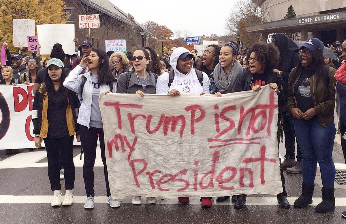 People protest on the University of Connecticut campus against the election of Republican Donald Trump as President Wednesday, Nov. 9, 2016, in Storrs, Conn. (AP Photo/Pat Eaton-Robb)
