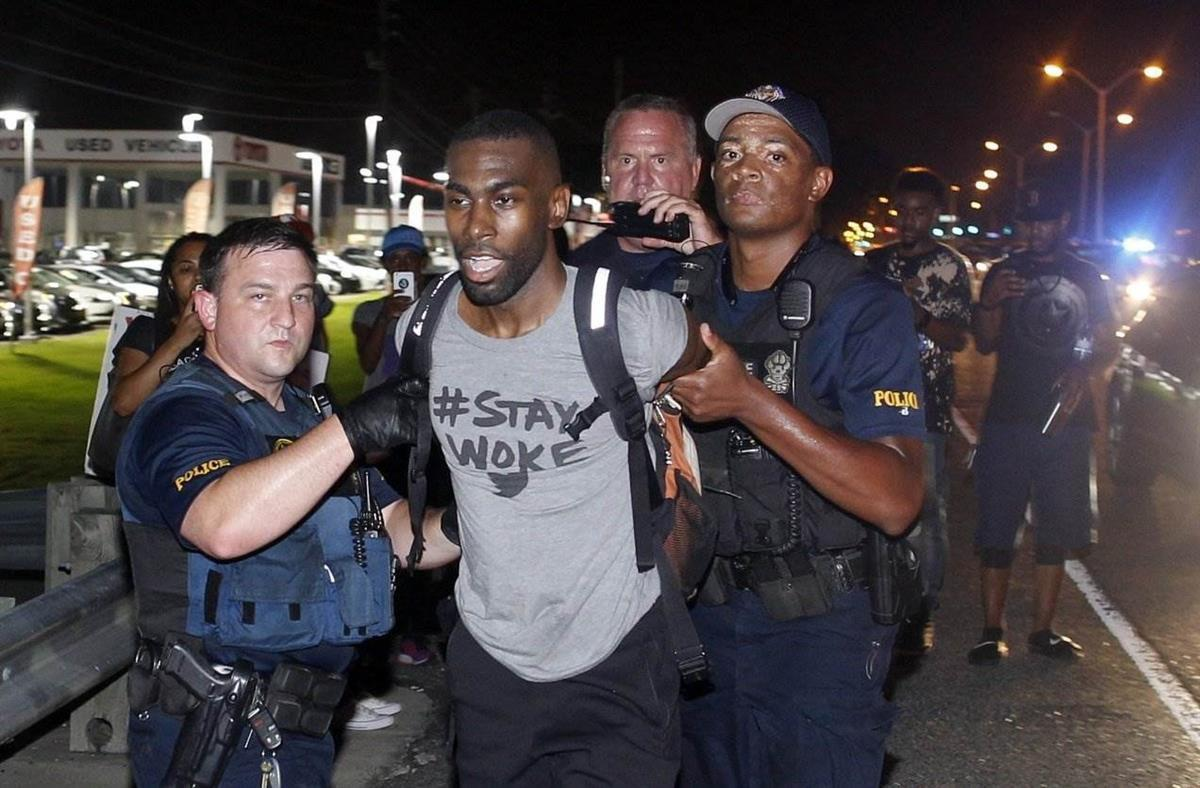 On July 9, 2016, DeRay Mckesson is arrested in Baton Rouge, Louisiana following the shooting of Alton Sterling (Max Becherer/AP).