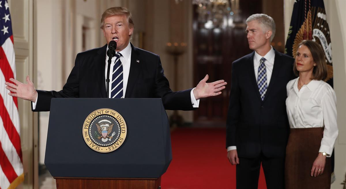 President Donald Trump speaks in the East Room of the White House in Washington, Tuesday, Jan. 31, 2017, to announce Judge Neil Gorsuch as his nominee for the Supreme Court. Gorsuch stands with his wife Louise. (AP Photo/Carolyn Kaster)