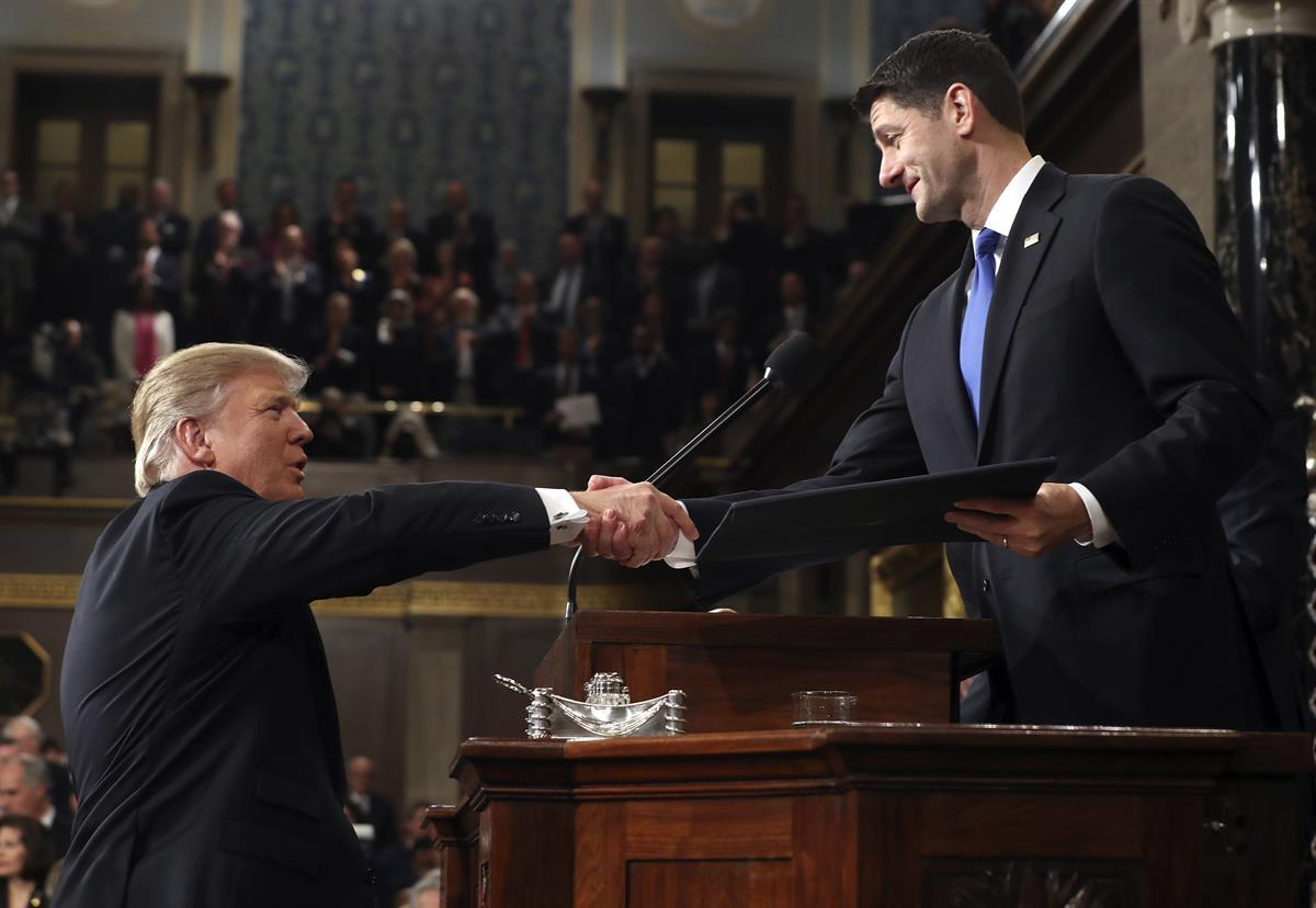President Donald Trump shakes hands with House Speaker Paul Ryan of Wis., as he arrives on Capitol Hill in Washington, Tuesday, Feb. 28, 2017, for his address to a joint session of Congress. (Jim Lo Scalzo/Pool Image viaAP)
