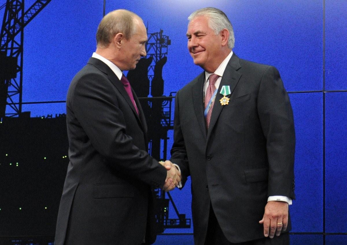 "President Vladimir Putin awarding Rex Tillerson the ""Order of Friendship"" (AP)"