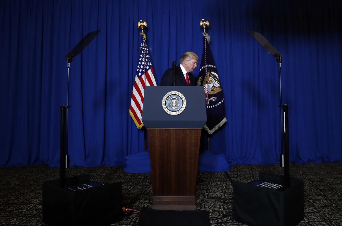 President Donald Trump walks away from the podium after speaking on the Syria strike — Mar-a-Lago in Palm Beach, Fla. Thursday, April 6, 2017. (AP)