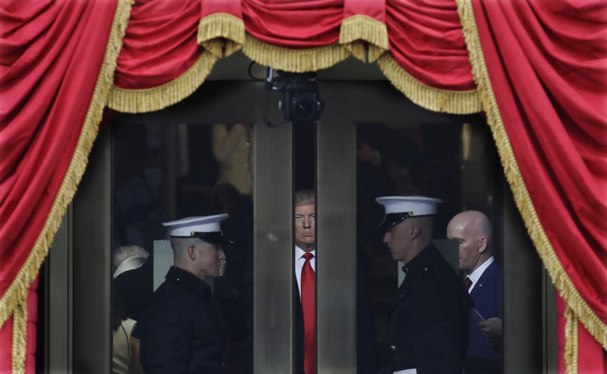Donald Trump waits to step out onto the portico for his Presidential Inauguration at the U.S. Capitol in Washington—Friday, Jan. 20, 2017. (AP Photo/Patrick Semansky)