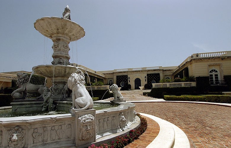 A large water fountain is seen in the driveway of Donald Trump's house in Palm Beach, Florida, that sold to Russian oligarch Dmitry Rybolovlev in 2008.