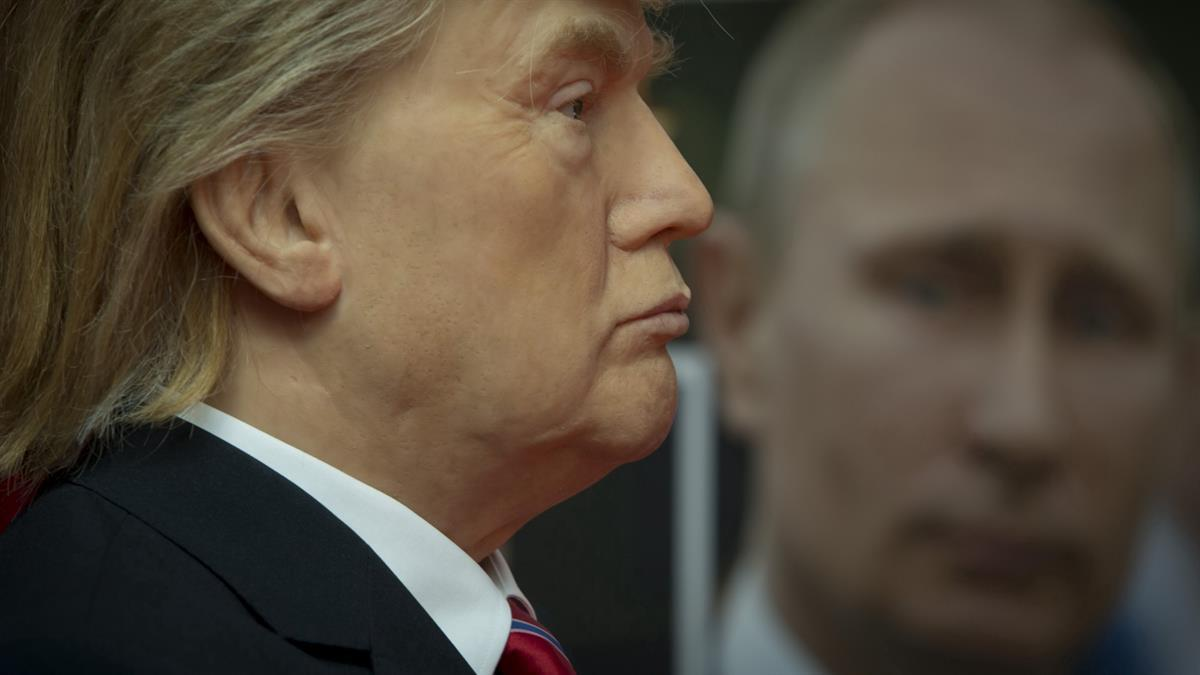 Wax model of President Donald Trump stands near a portrait of Russian President Vladimir Putin, displayed in the wax museum in Sofia, Bulgaria — Friday March 31, 2017 (AP Photo/Valentina Petrova)