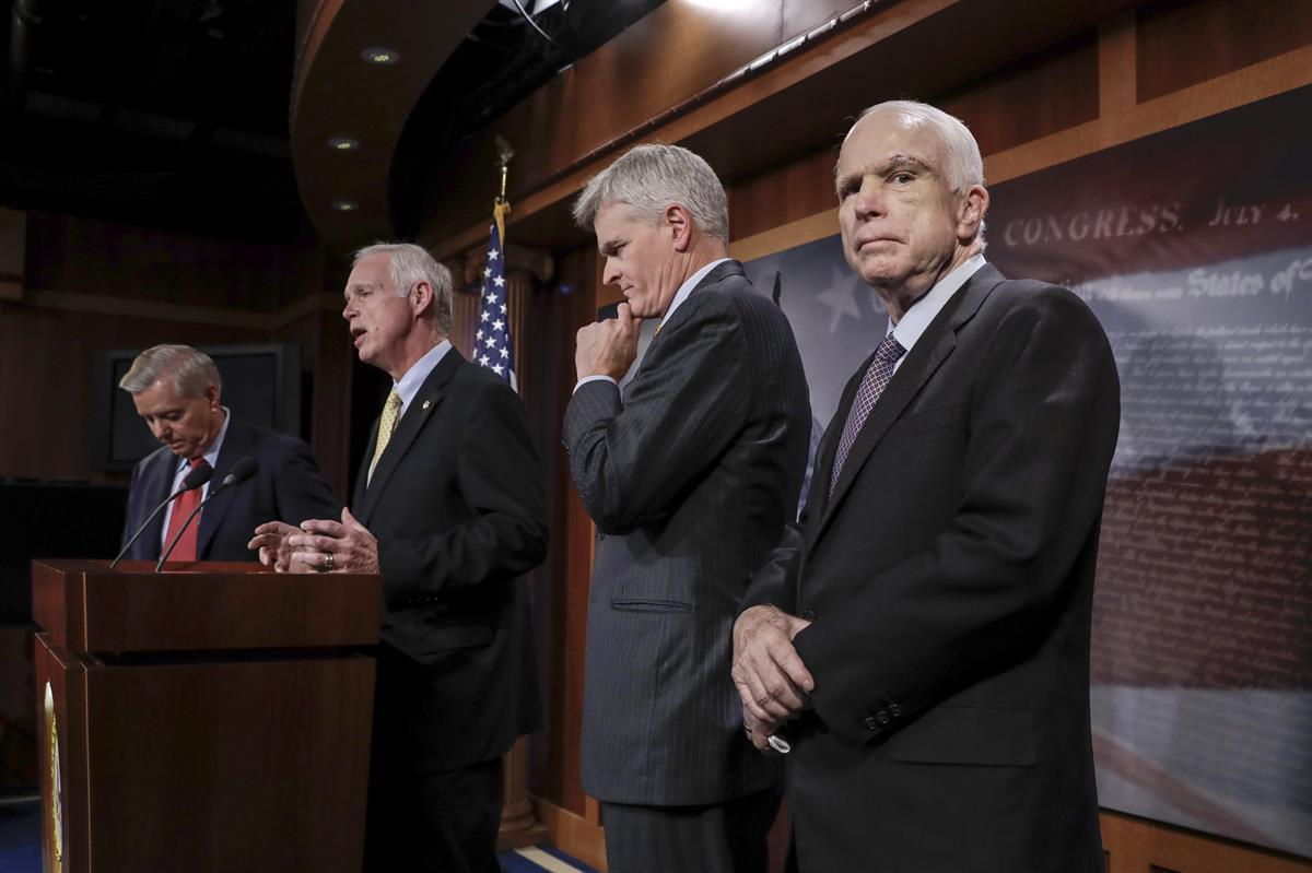 From left, Sen. Lindsey Graham, R-S.C., Sen. Ron Johnson, R-Wis., Sen. Bill Cassidy, R-La., and Sen. John McCain, R-Ariz., speak to reporters at the Capitol — Thursday, July 27, 2017. (AP/J. Scott Applewhite)