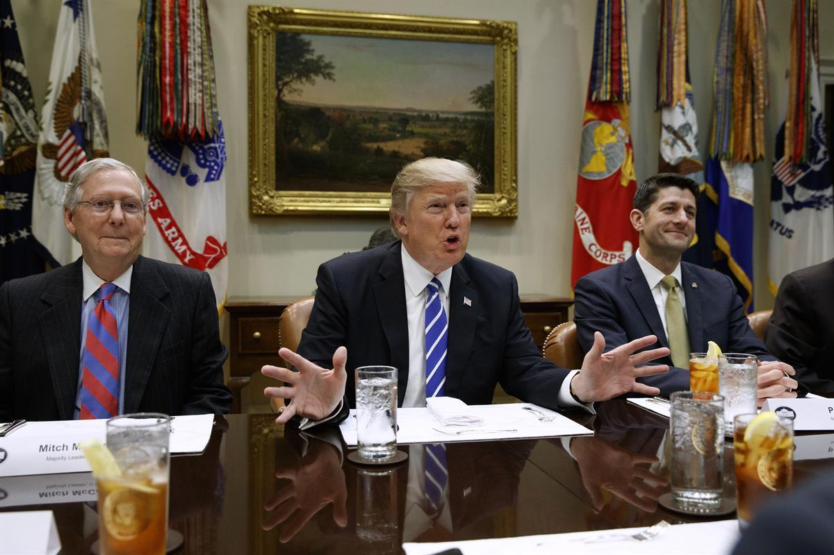 President Donald Trump, Senate Majority Leader Mitch McConnell (left), and Speaker of the House Paul Ryan (right) (AP/Evan Vucci)