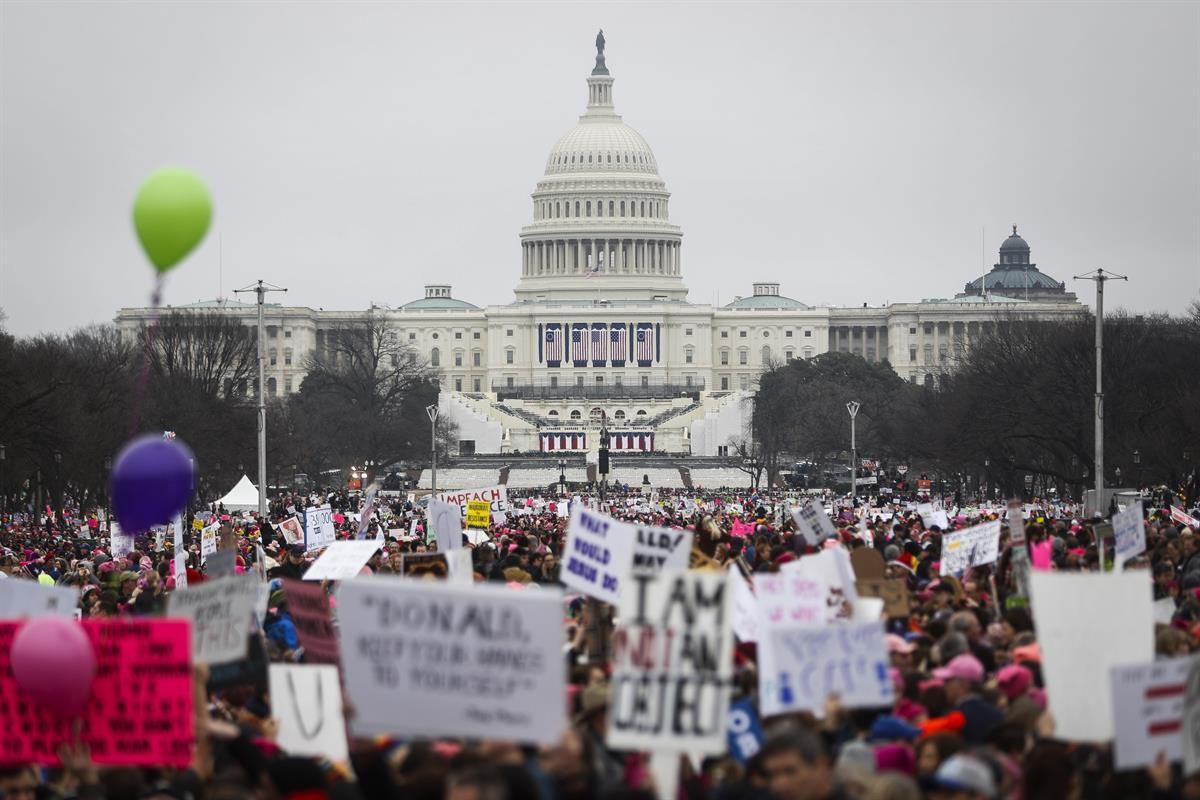 Protesters gather on the National Mall for the Women's March on Washington during the first full day of Donald Trump's presidency - Saturday, Jan. 21, 2017. (AP Photo/John Minchillo)