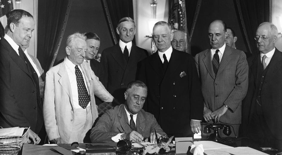 Franklin Roosevelt signs the Glass-Steagall banking reform act—June 16, 1933 (Everett Collection/Newscom)