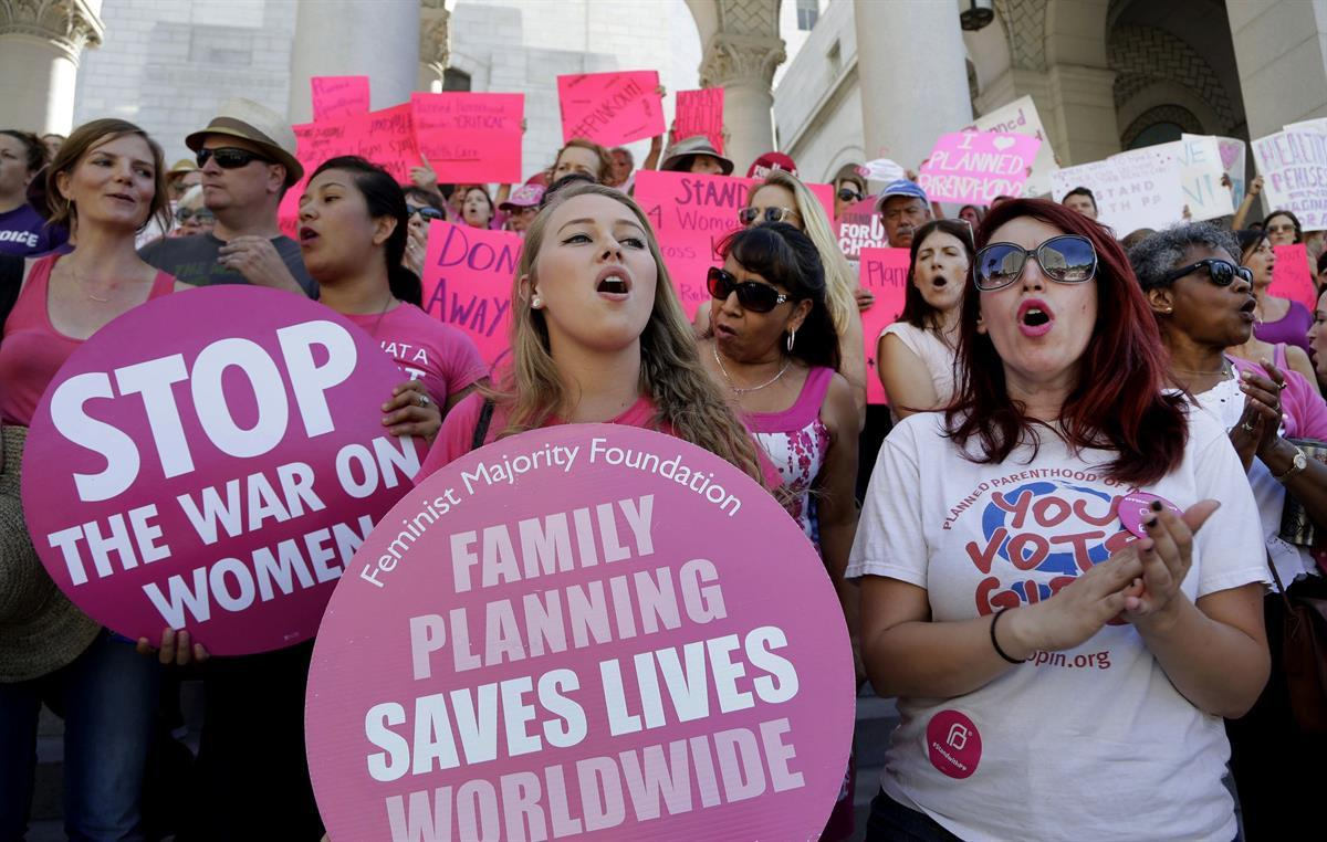 "Planned Parenthood supporters rally for women's access to reproductive health care on ""National Pink Out Day'' at Los Angeles City Hall — Sept. 9, 2015 (AP/Nick Ut, File)"