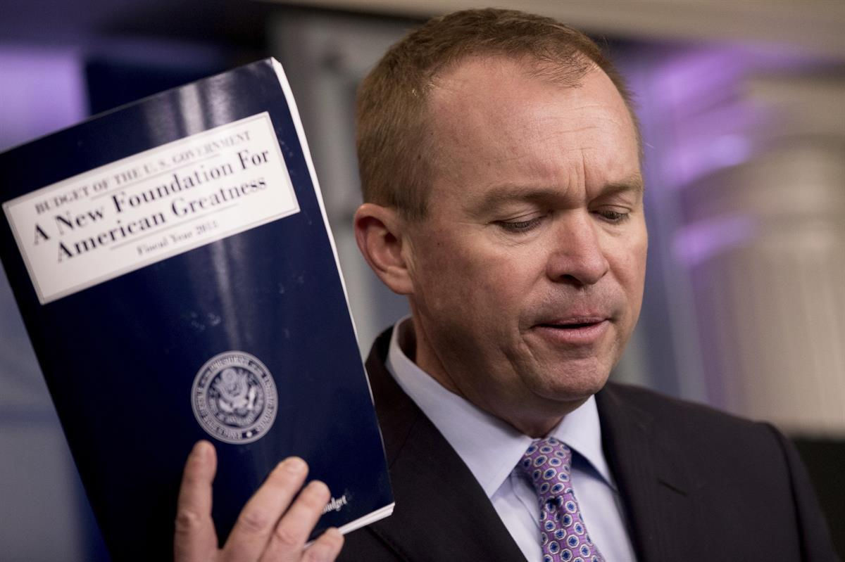 Budget Director Mick Mulvaney holds up a copy of President Donald Trump's proposed fiscal 2018 federal budget—Tuesday, May 23, 2017. (AP Photo/Andrew Harnik)