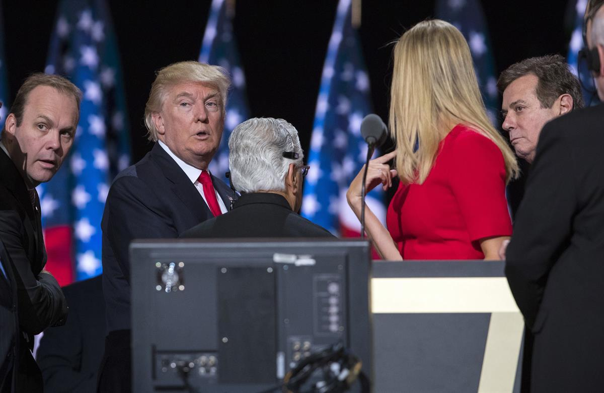 In this July 21, 2016, photo, then-Republican presidential candidate Donald Trump, his daughter Ivanka Trump, then-campaign manager Paul Manafort, right, and Rick Gates, left, on stage during a walk through at the Republican National Convention, Thursday, July 21, 2016, in Cleveland. (AP Photo/Evan Vucci)