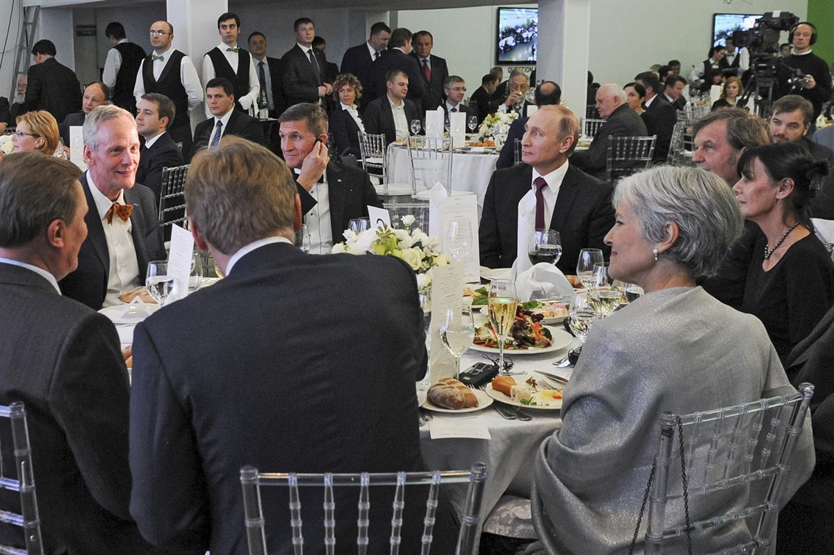 Russian President Vladimir Putin, center right, with retired U.S. Lt. Gen. Michael T. Flynn, center left. Michael Flynn was in attendance of the 10th anniversary of RT (the Russian government's propaganda network). Flynn acknowledged that he was paid to attend the event. And yes, that is former Green Party candidate Jill Stein — Dec. 10, 2015 (Mikhail Klimentyev/Sputnik, Kremlin Pool Photo via AP)
