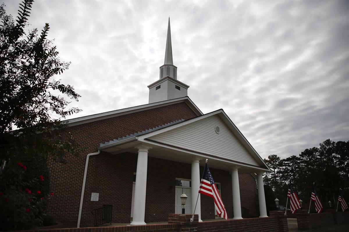 American flags are displayed in front of the First Baptist Church of Gallant (Roy Moore's home church)?—?Sunday, Nov. 12, 2017, in Gallant, Alabama (AP Photo/Brynn Anderson)