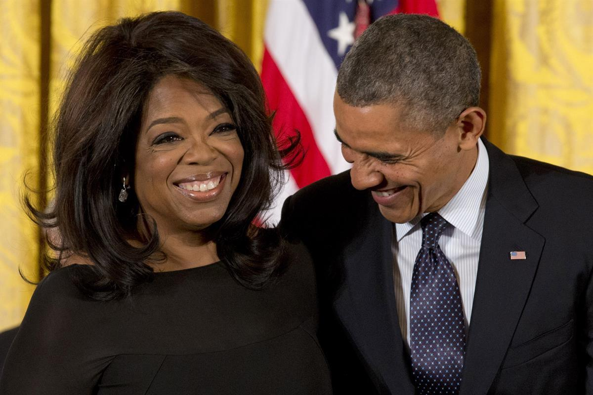 President Barack Obama laughs with Oprah Winfrey in the East Room of the White House in Washington, Wednesday, Nov. 20, 2013, before awarding her the Presidential Medal of Freedom . (AP Photo/Jacquelyn Martin)