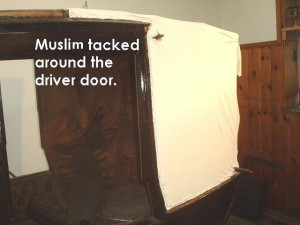 Muslim tacked around driver door