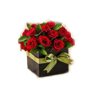 12 red roses in a round keepsake black box