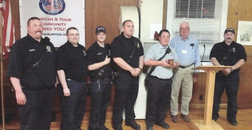 Captain Jeff Foster (third from right,  holding cup) and members of Station 9 VDF fire and rescue team with Belmont Ruritan President Bobby Goodwin (second from right)