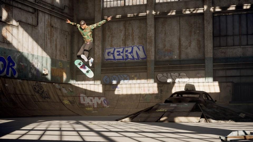 A skater midair, jumping off a skateboard