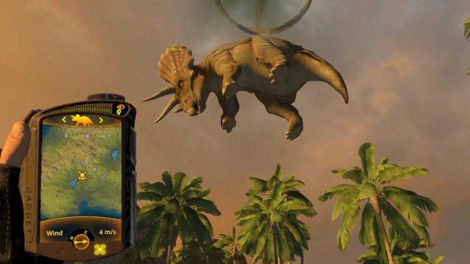 A triceratops being airlifted with the gadget from the game Carnivores: Dinosaur Hunt in the foreground