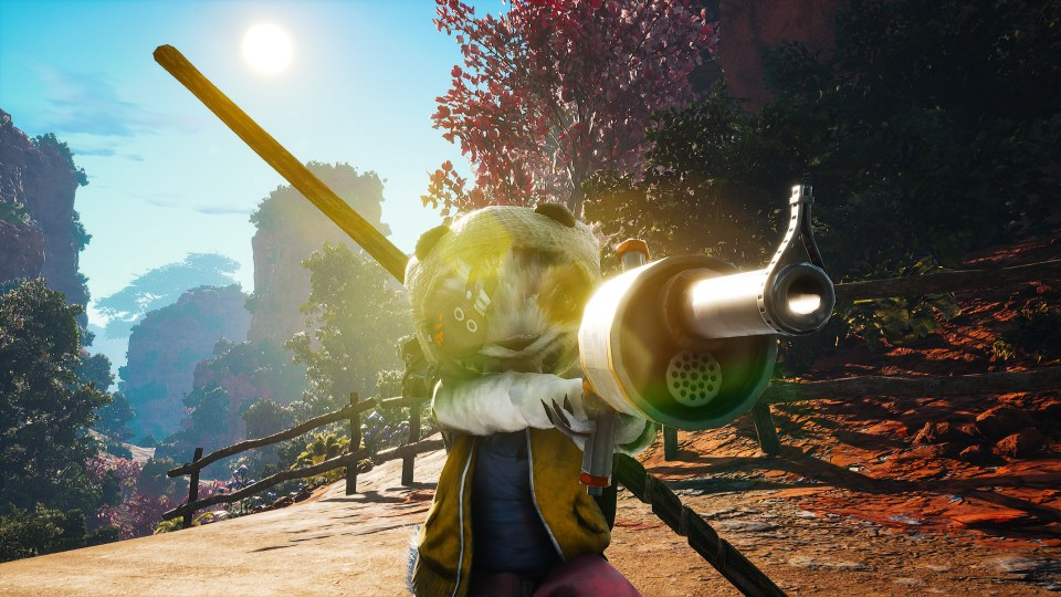 My Biomutant character points a gun towards the camera, with a sun flare glinting off the gun and its face.
